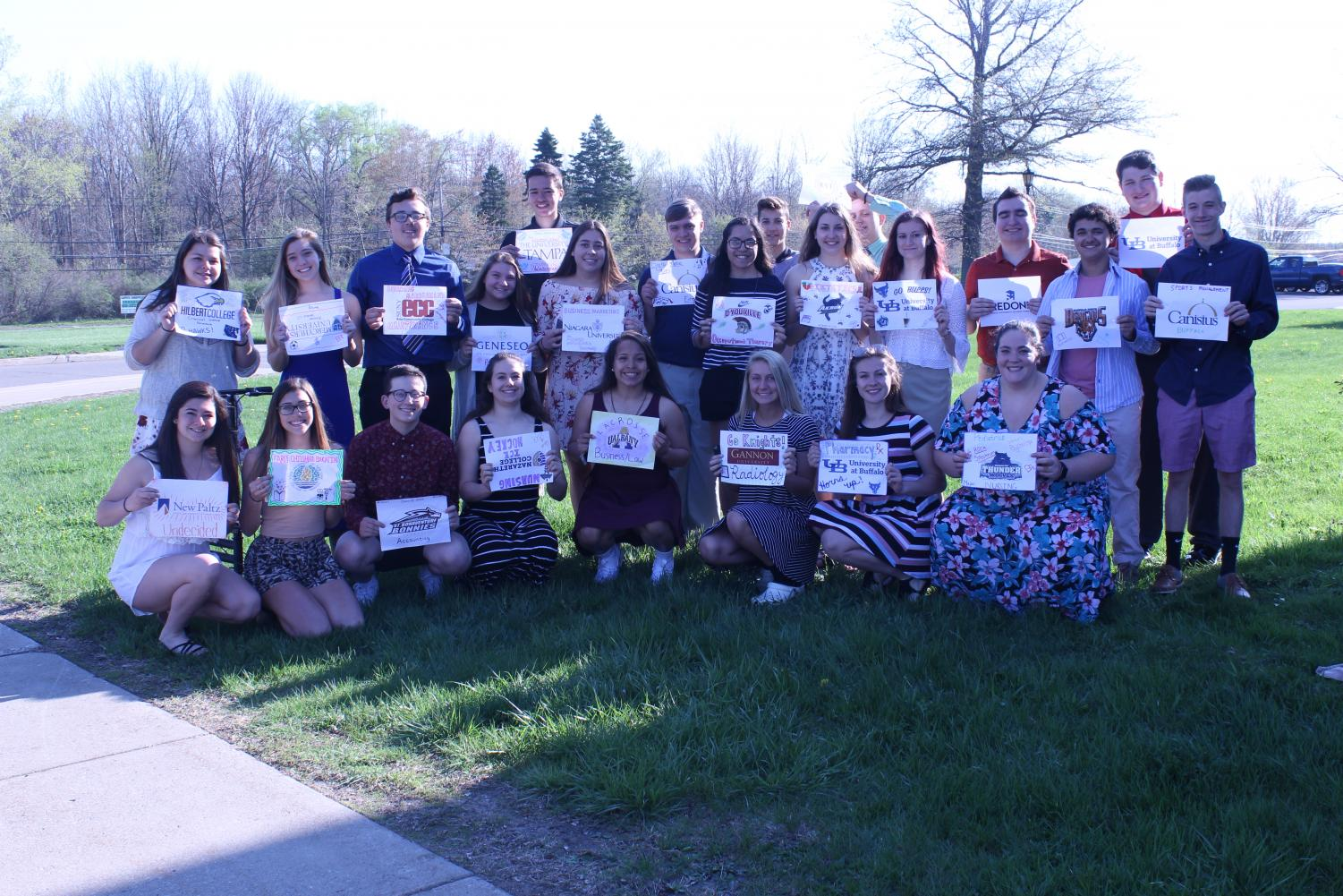 Academy of Business and Finance Seniors holding signs of their college choice