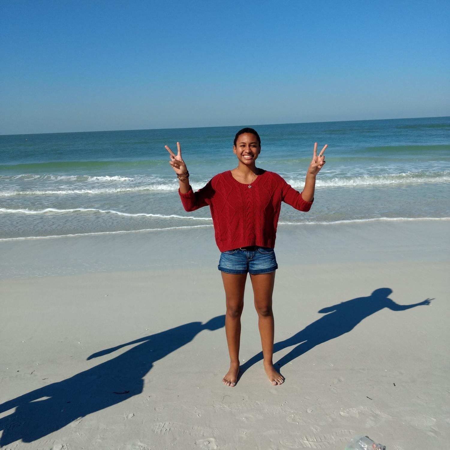 Senior Class President, Mathea Riley, poses on the beach.