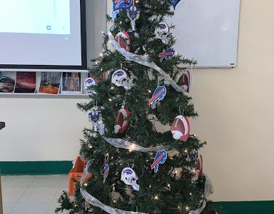 Ms. Morgan, Buffalo Bills Fanatic and English teacher here at Lake Shore, displays her mafia- inspired Christmas tree.